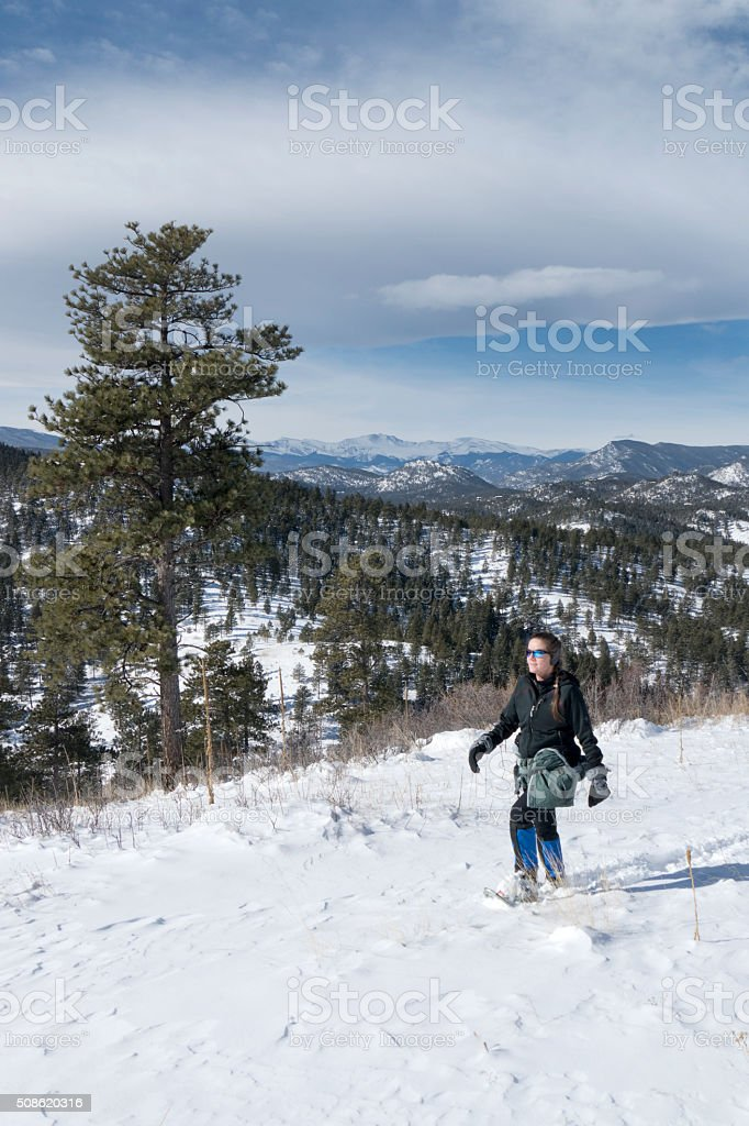 Snowshoeing snowy mountain trail and Mount Evans Colorado stock photo