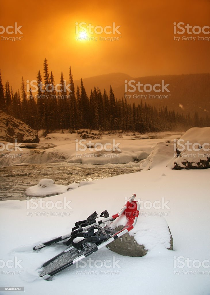 Snowshoes and Sunset royalty-free stock photo