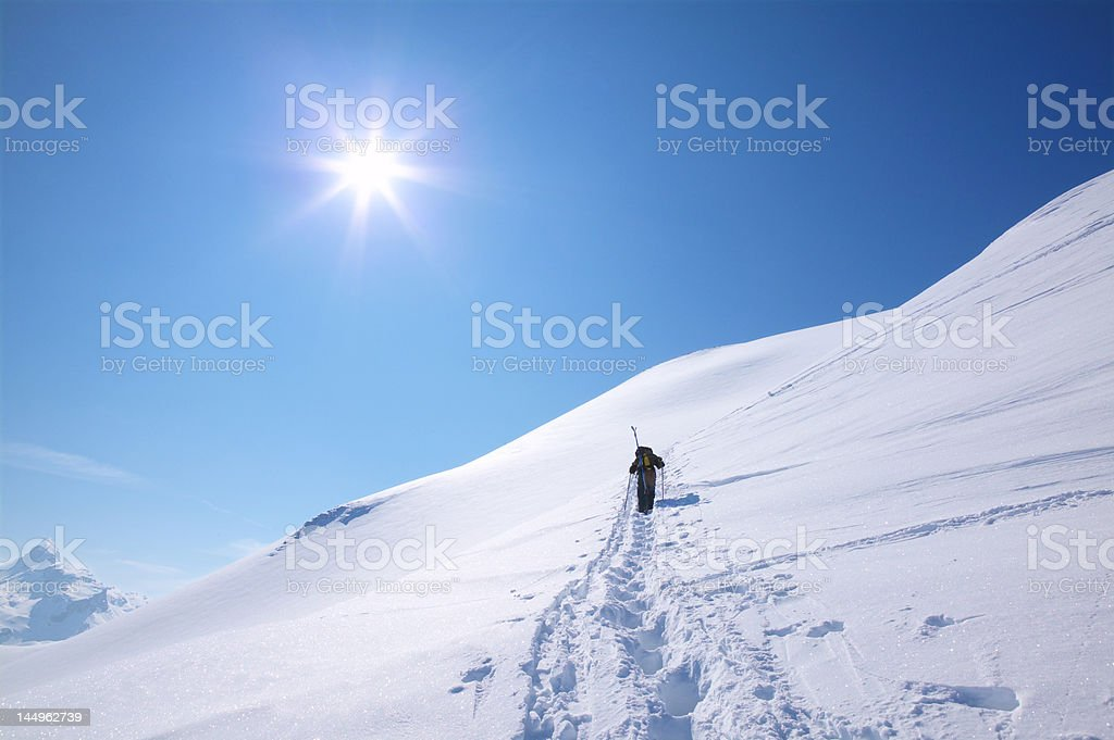 Snowshoetrekking in the mountains royalty-free stock photo