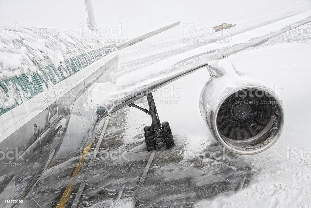 Snowstorm and air travel stock photo