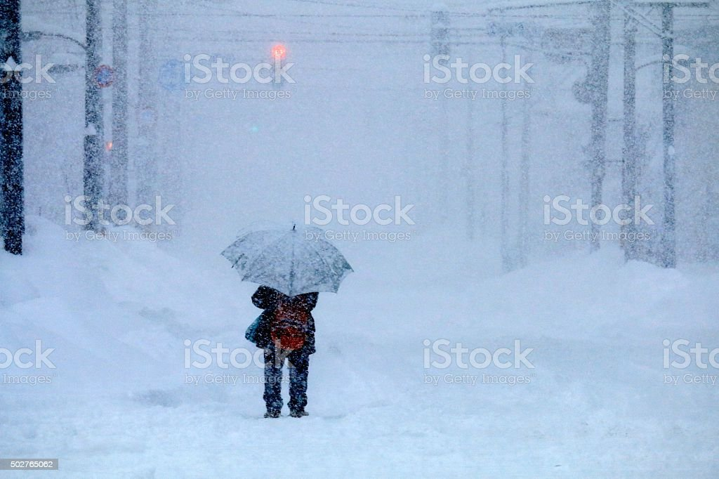 Snowstorm and women stock photo