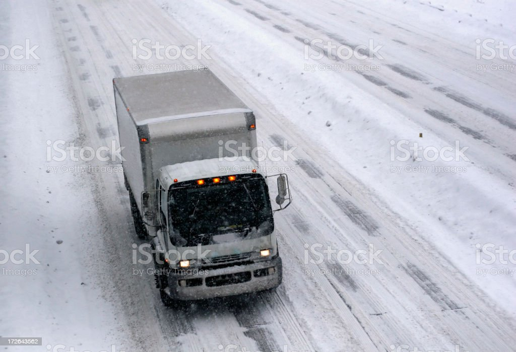 Snowstorm Trucking royalty-free stock photo