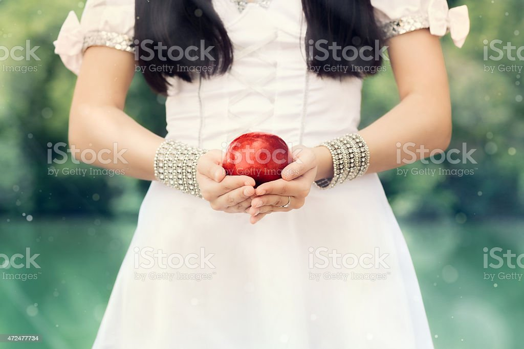 Snow-White Princess with Famous Red Apple stock photo