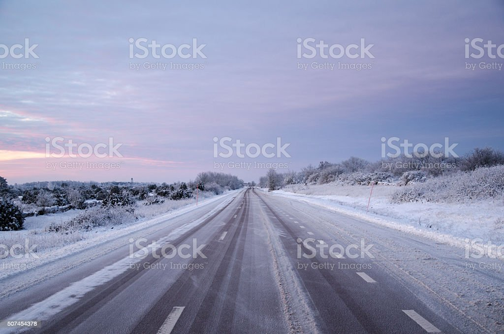 Snowy asphalt country road stock photo