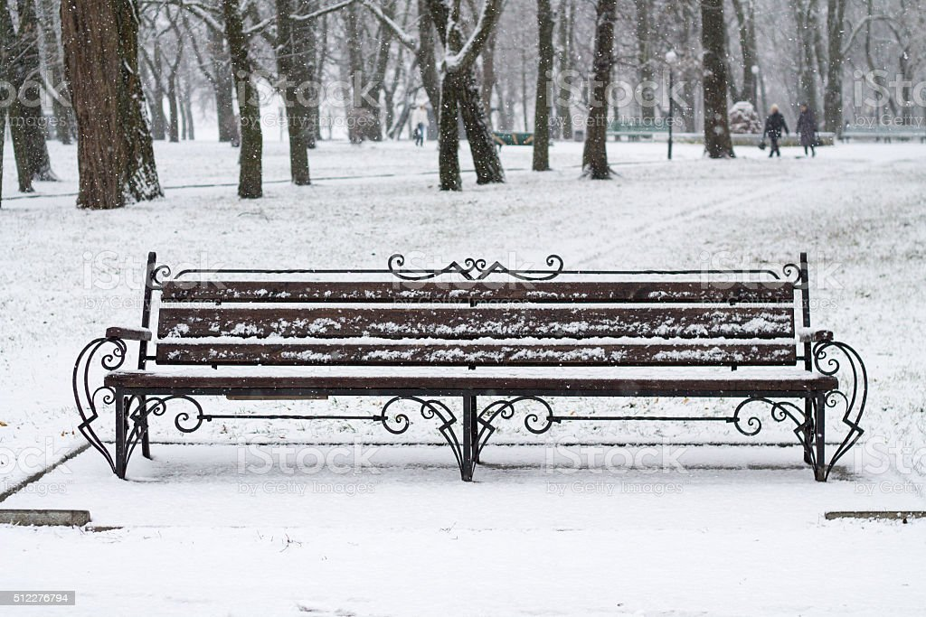 Snowy Bench in Park stock photo