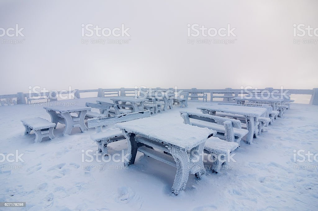 Snowy bench in winter stock photo