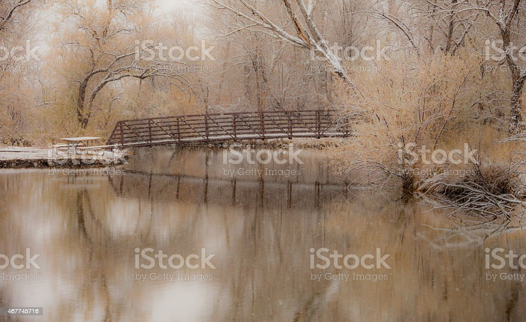 Snowy Bridge Reflection stock photo