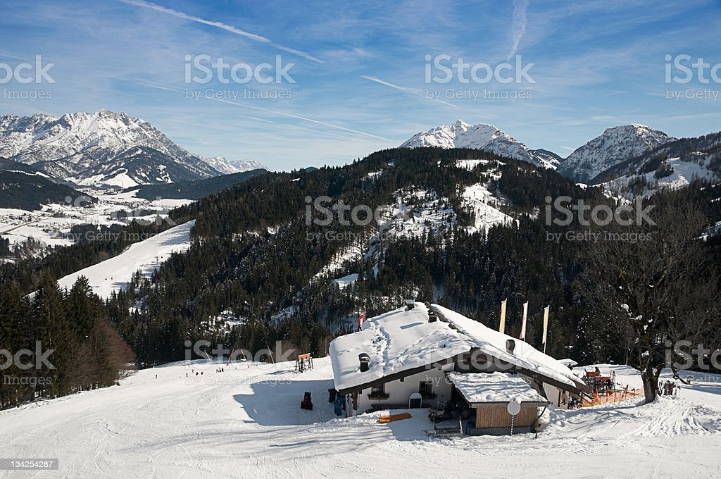 Snowy cabin in the mountains stock photo