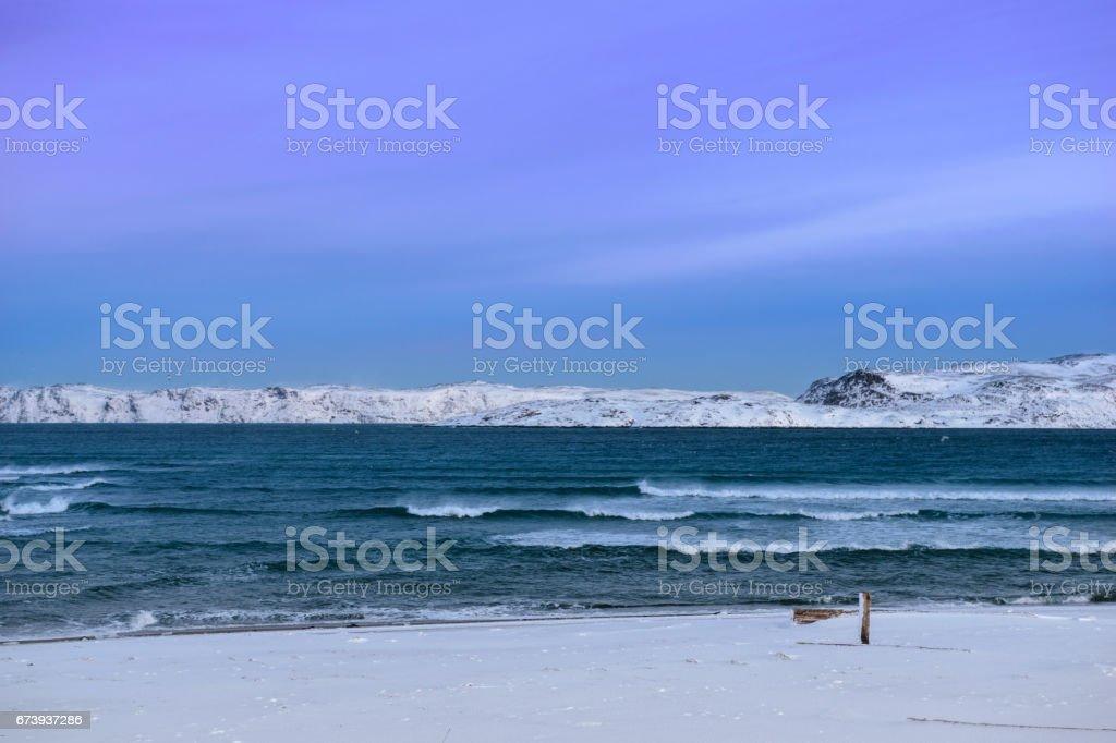 Snowy coast of Barents Sea in Teriberka, Murmansk Region, Russia stock photo
