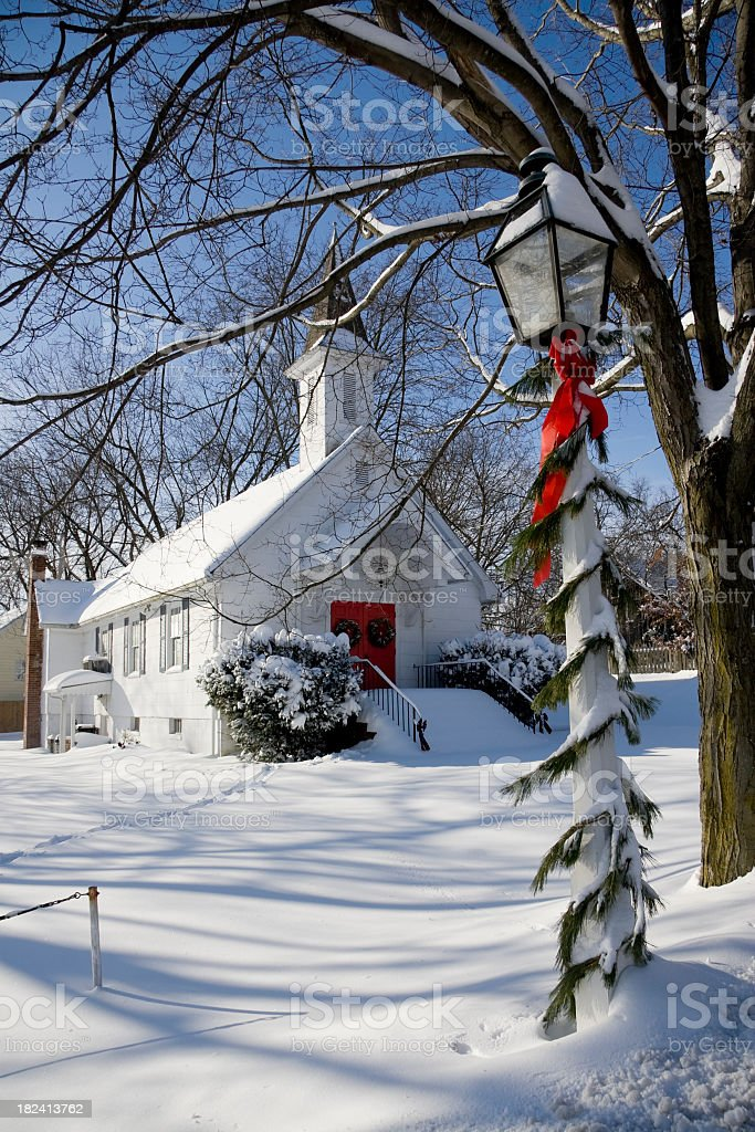 Snowy Country Church at Christmas Time stock photo