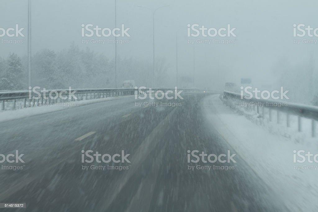 snowy danger road stock photo