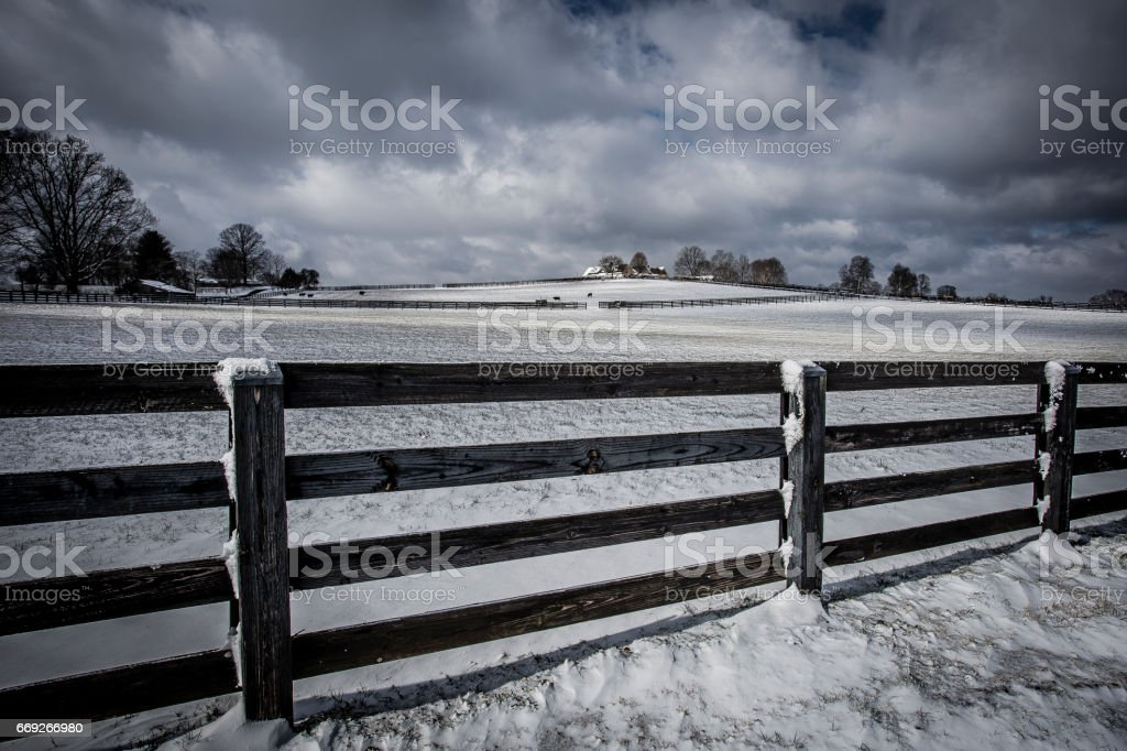 Snowy fence in the country side 2 stock photo