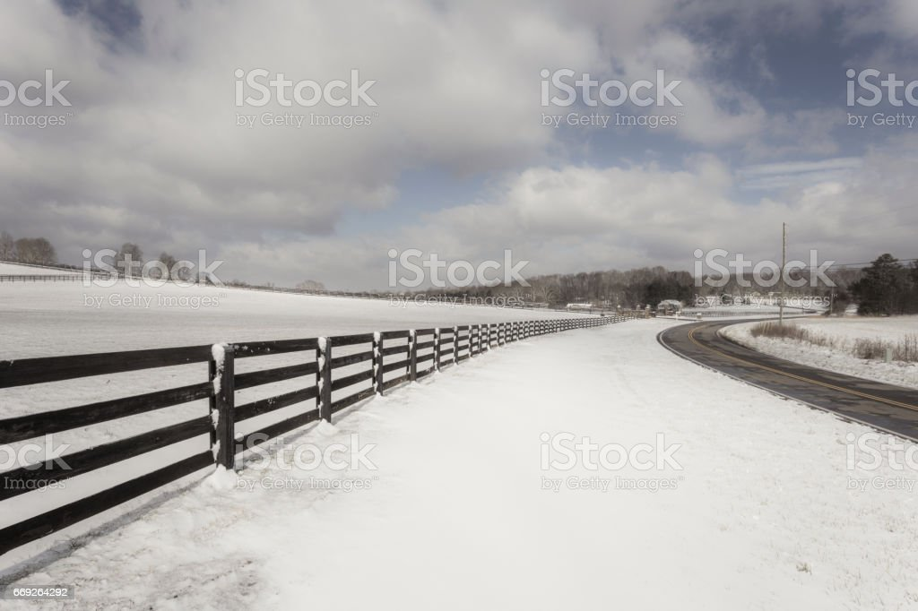Snowy fence in the country side stock photo