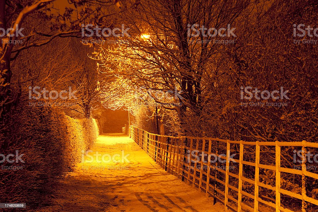 Snowy Footpath at Night stock photo