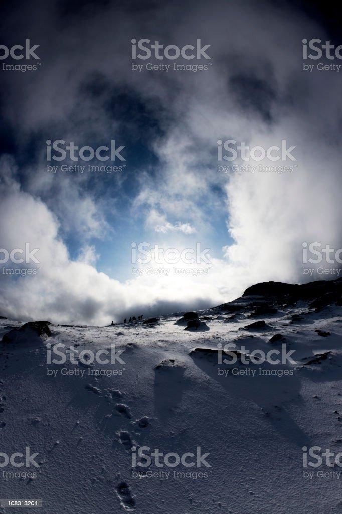 Snowy footprints up Haytor, Dartmoor stock photo
