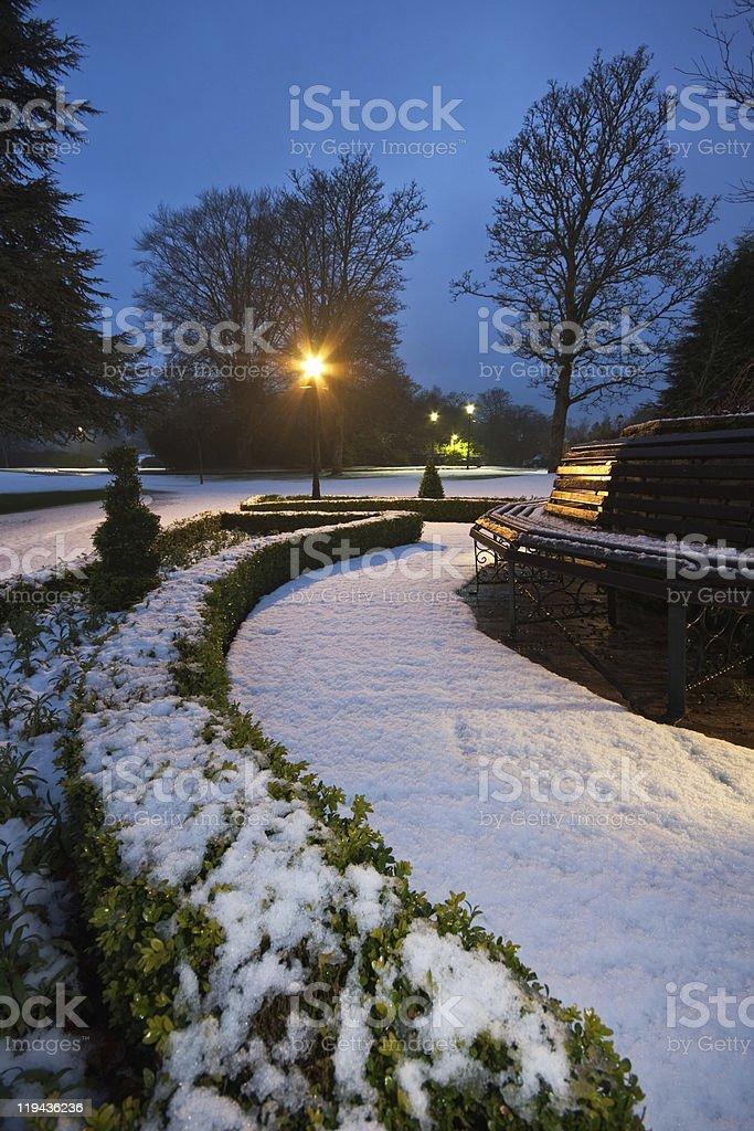 Snowy formal garden at dusk royalty-free stock photo