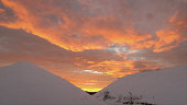 Snowy hills and golden sunrise