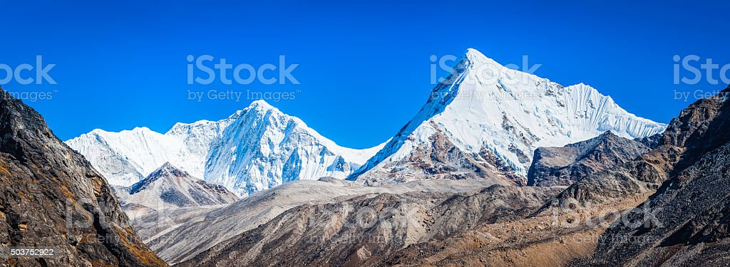 Snowy Himalayan mountain peaks Baruntse and Chonku Chuli panorama Nepal stock photo