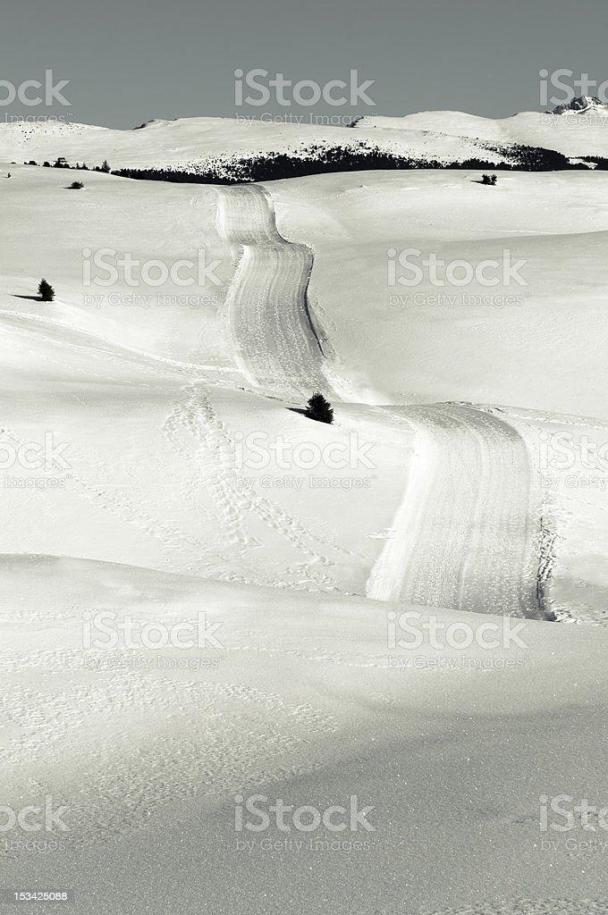 Snowy hump, mountain road stock photo