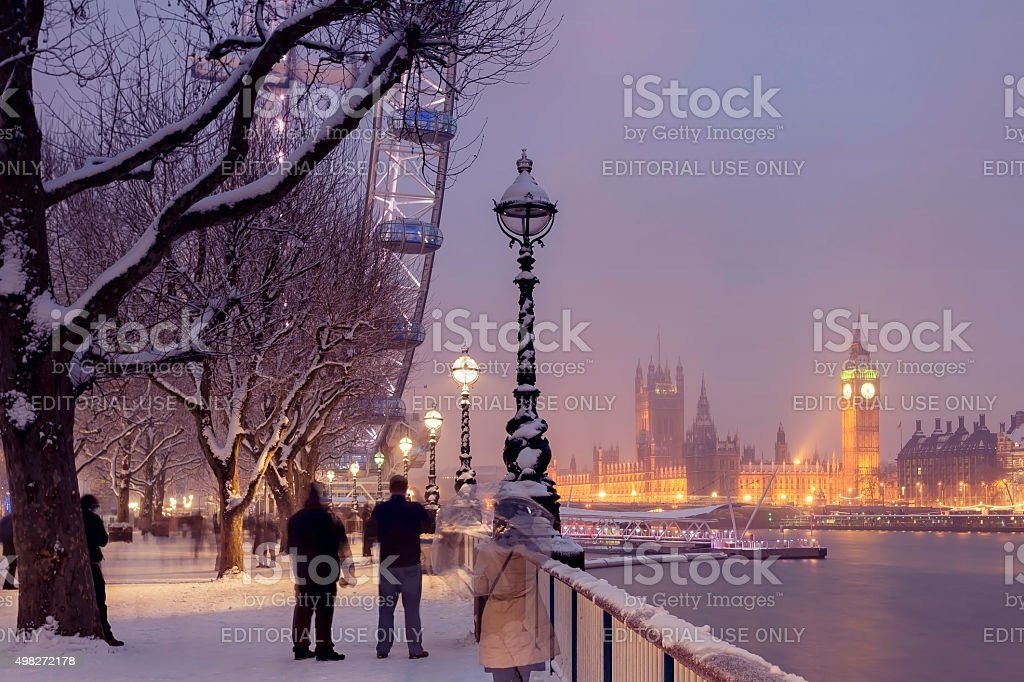 Snowy Jubilee Gardens and Westminster Palace in London stock photo