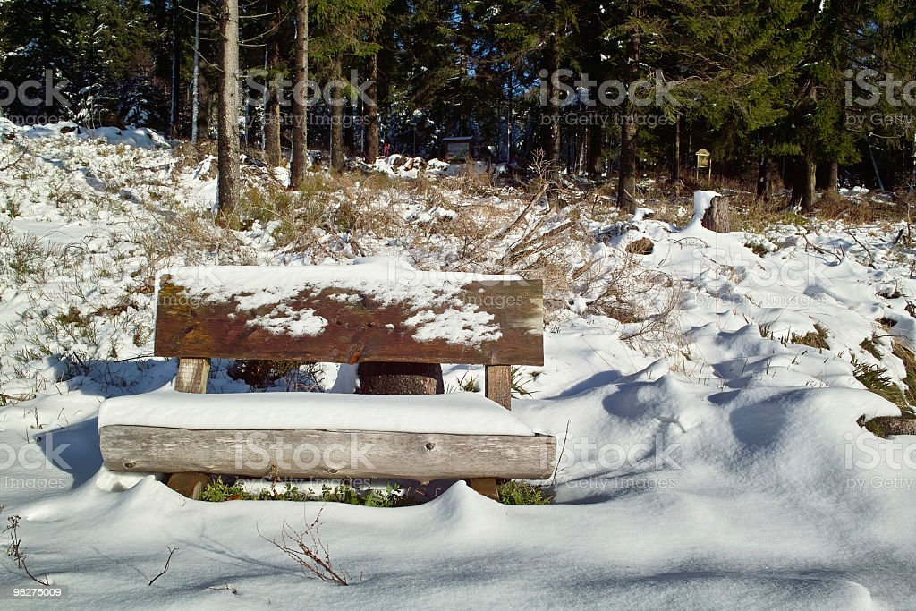 snowy landscape with bench royalty-free stock photo