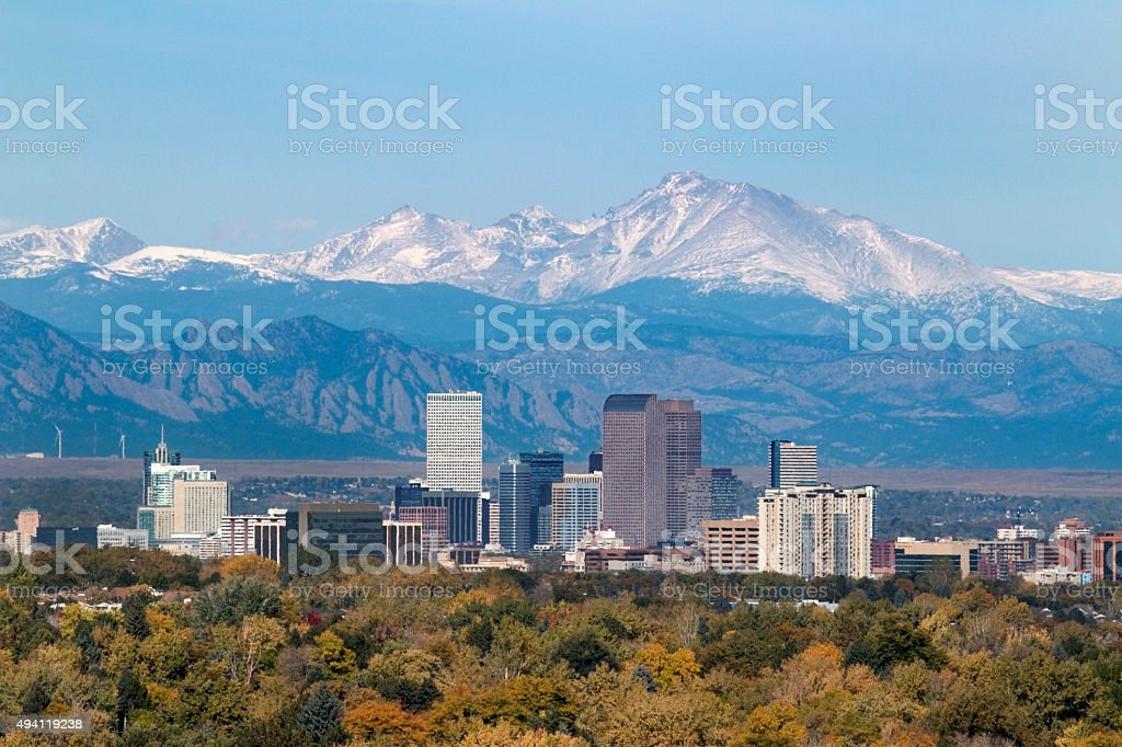 Snowy Longs Peak and Downtown Denver Colorado skyscrapers stock photo