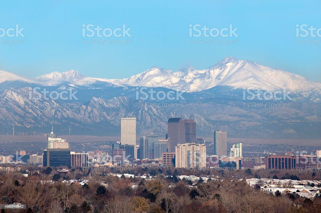 Snowy Longs Peak and Downtown Denver Colorado skyscrapers stock photo