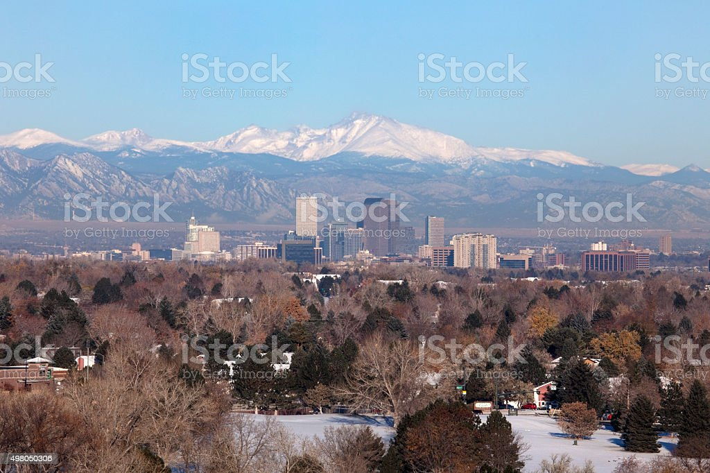 Snowy Longs Peak Rocky Mountains and Downtown Denver Colorado skyscrapers stock photo