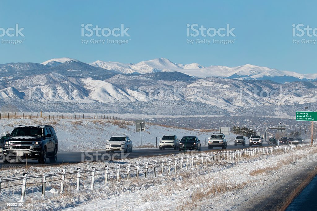 Snowy Mount Evans and Rocky Mountains with Colorado highway traffic stock photo