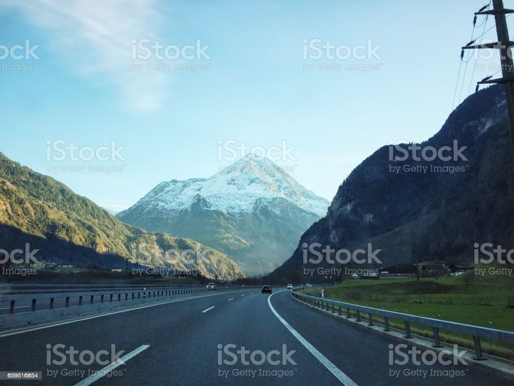 Snowy mountain from the highway stock photo