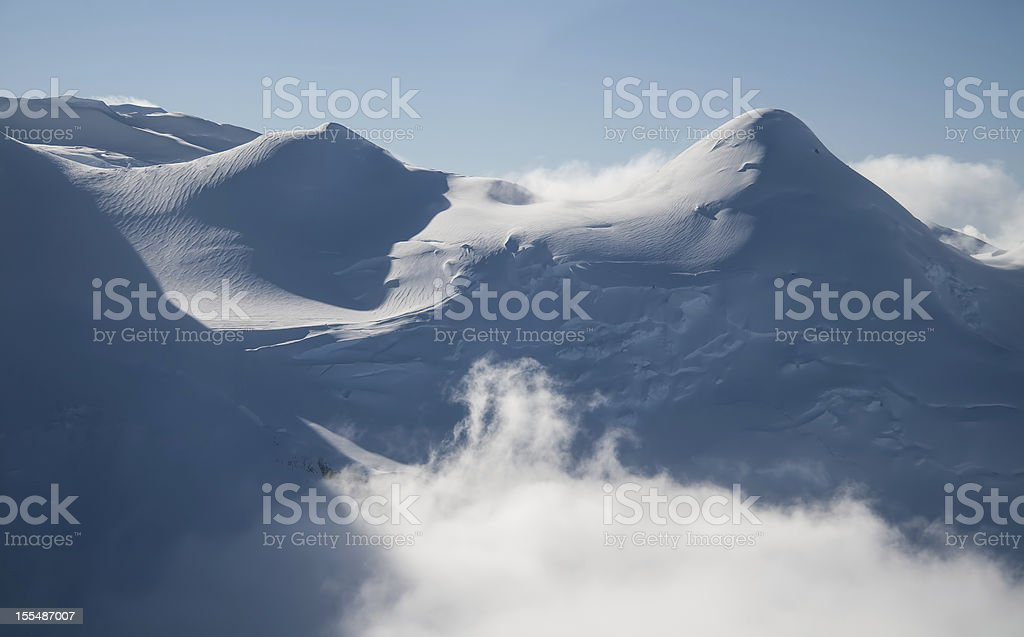 Snowy Mountain in the Clouds royalty-free stock photo