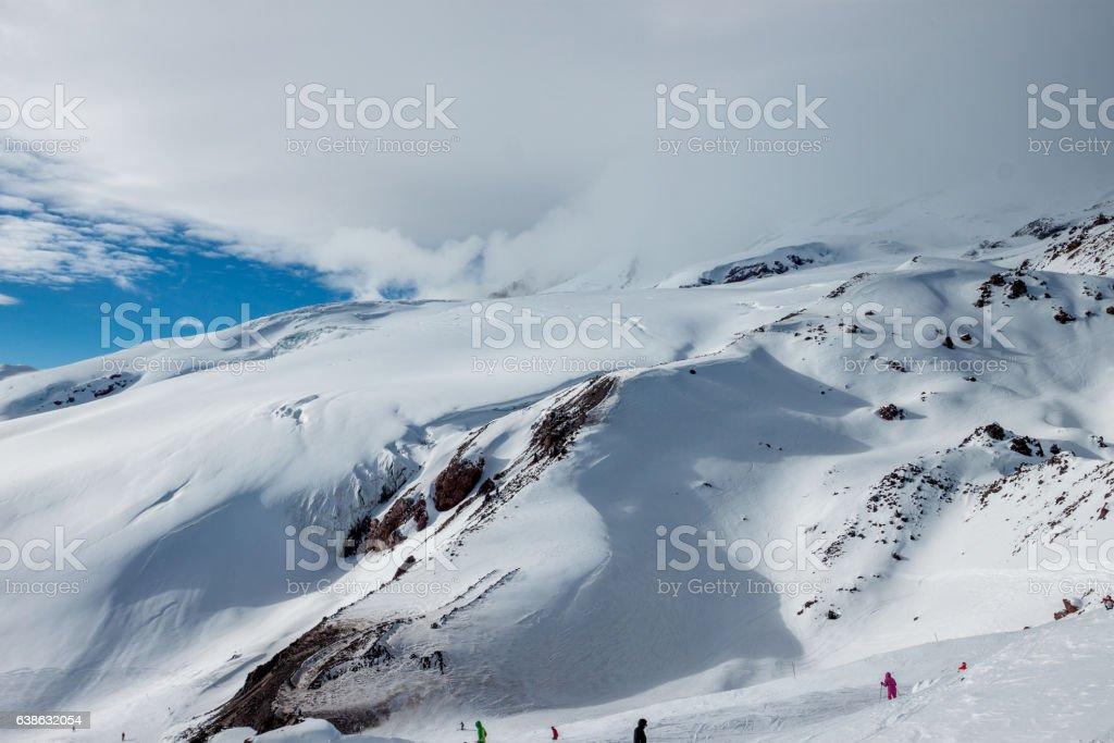 Snowy mountain landscape on the blue sky background. stock photo