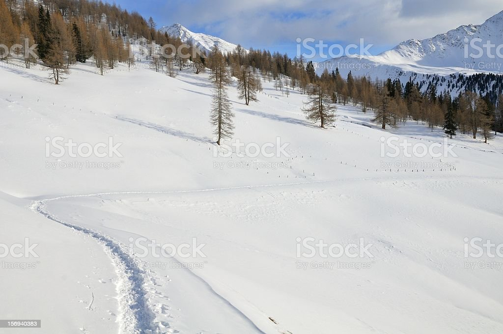 Snowy mountain landscape with snow shoes track stock photo