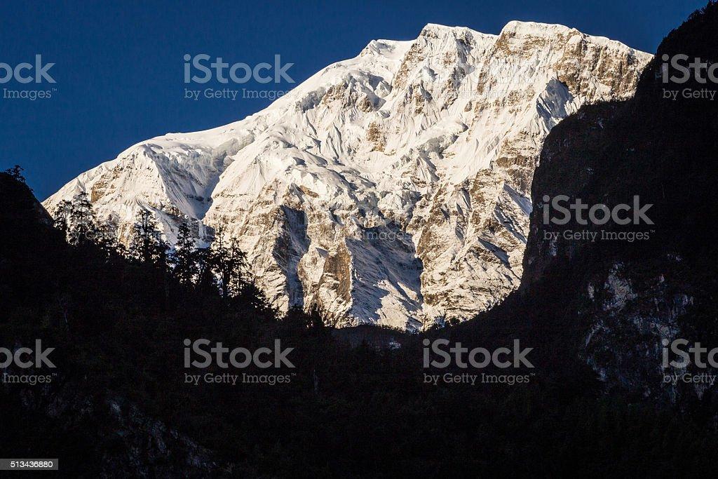 Snowy mountain peak and beautiful light stock photo