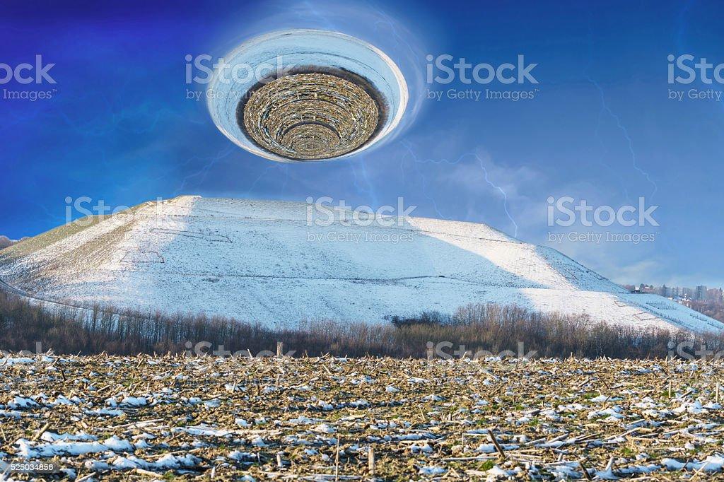 Snowy mountain with a giant hurricane stock photo
