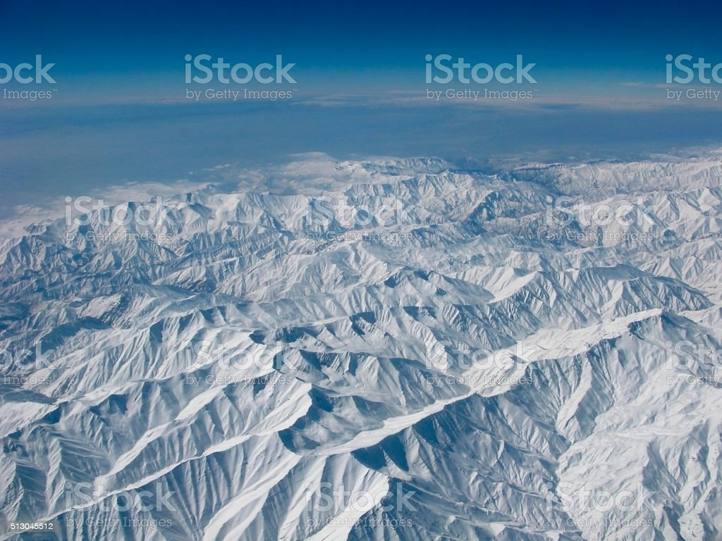 Snowy mountains aerial view stock photo