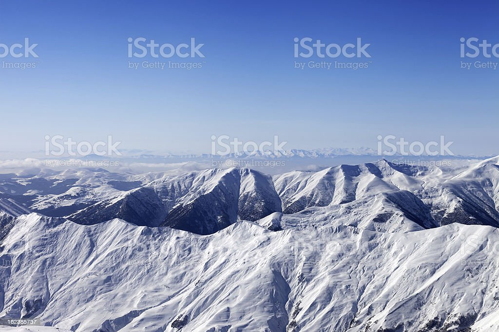 Snowy mountains and blue sky royalty-free stock photo
