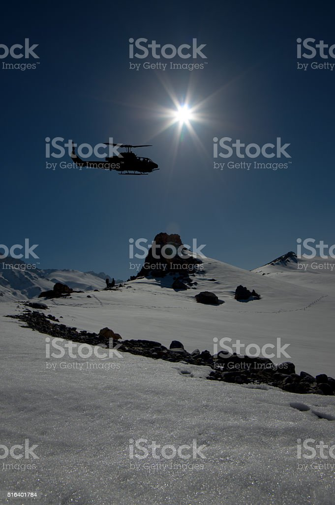 snowy mountains and helicopters stock photo