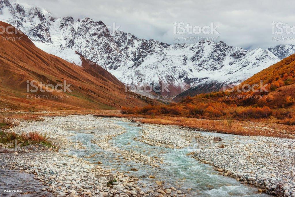 Snowy mountains and noisy mountain river. Georgia, Svaneti stock photo