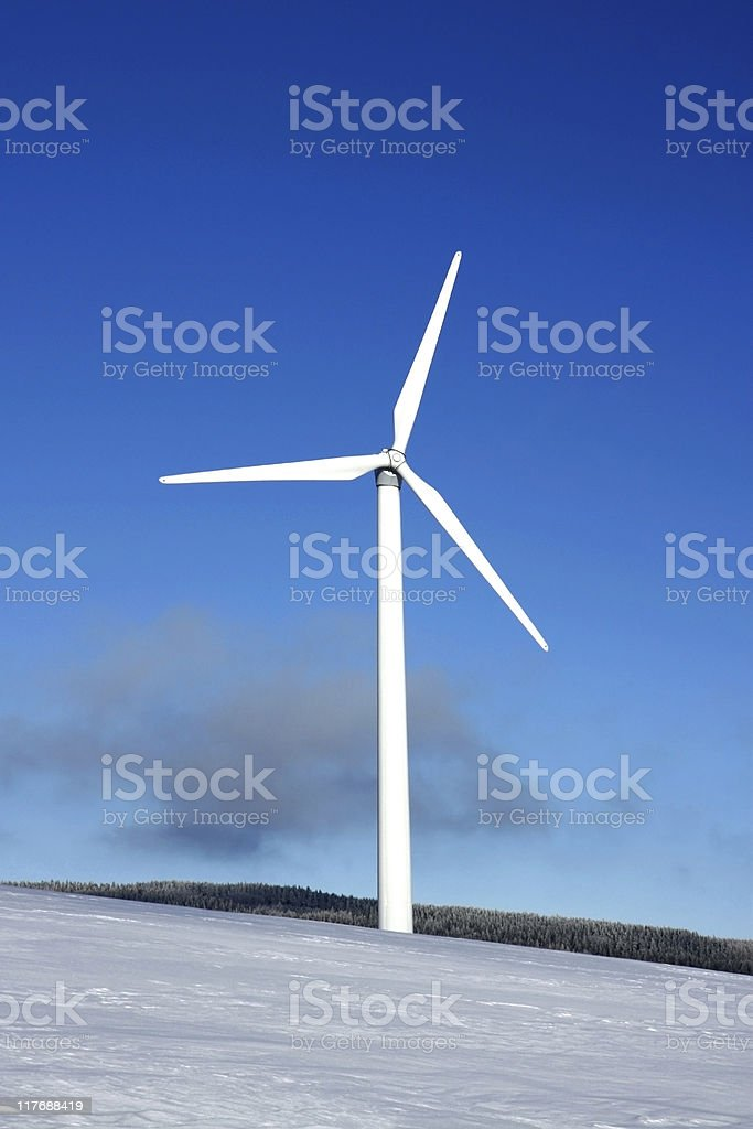 snowy mountains and wind power station royalty-free stock photo