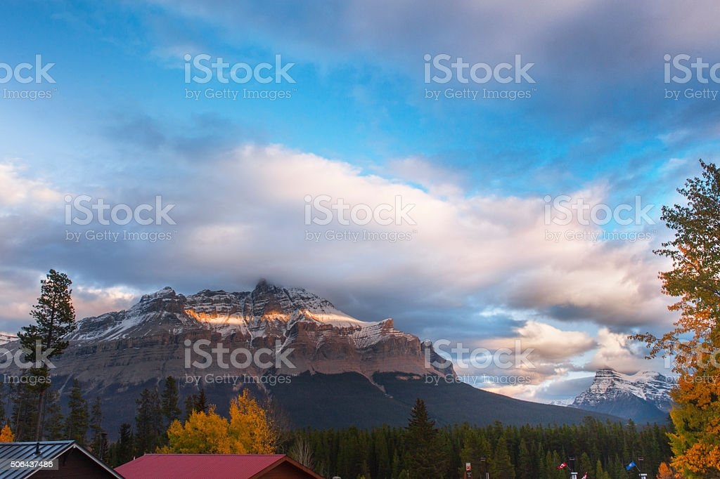 Snowy mountains  in dusk stock photo