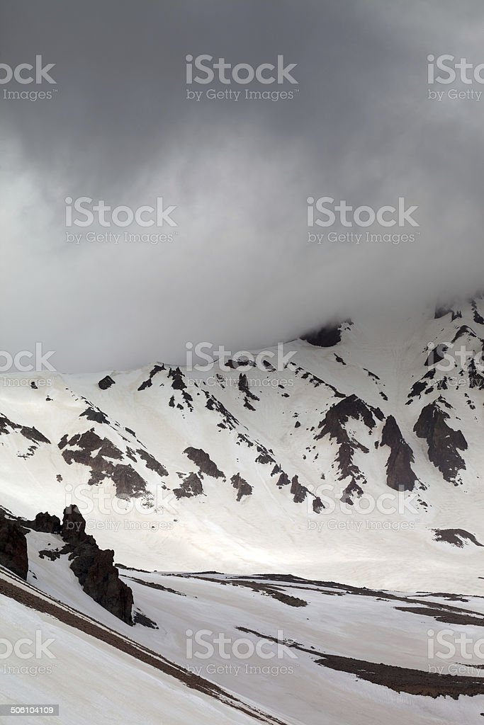 Snowy mountains in fog stock photo