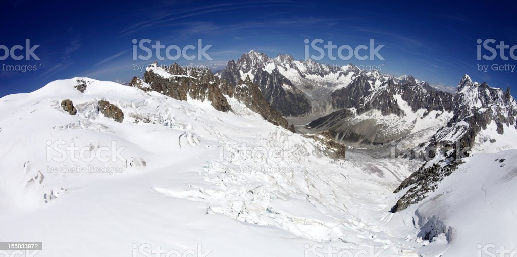 Snowy mountains in Mont Blanc Massif under blue sky. royalty-free stock photo