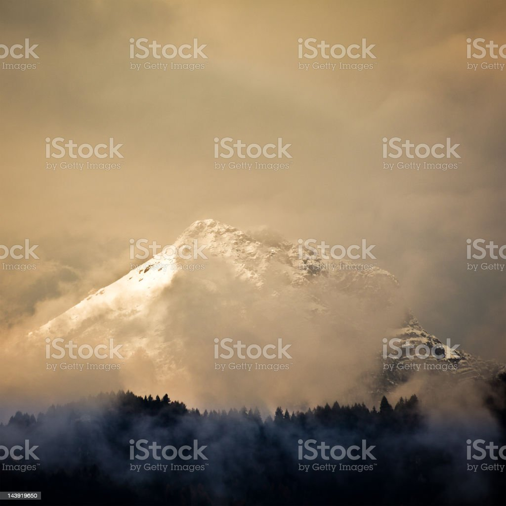 Snowy Mountains of Dolomites with Fog stock photo
