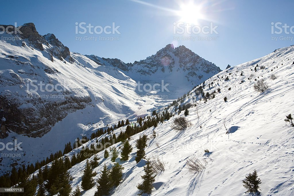Snowy mountains under the sun in French Alps royalty-free stock photo