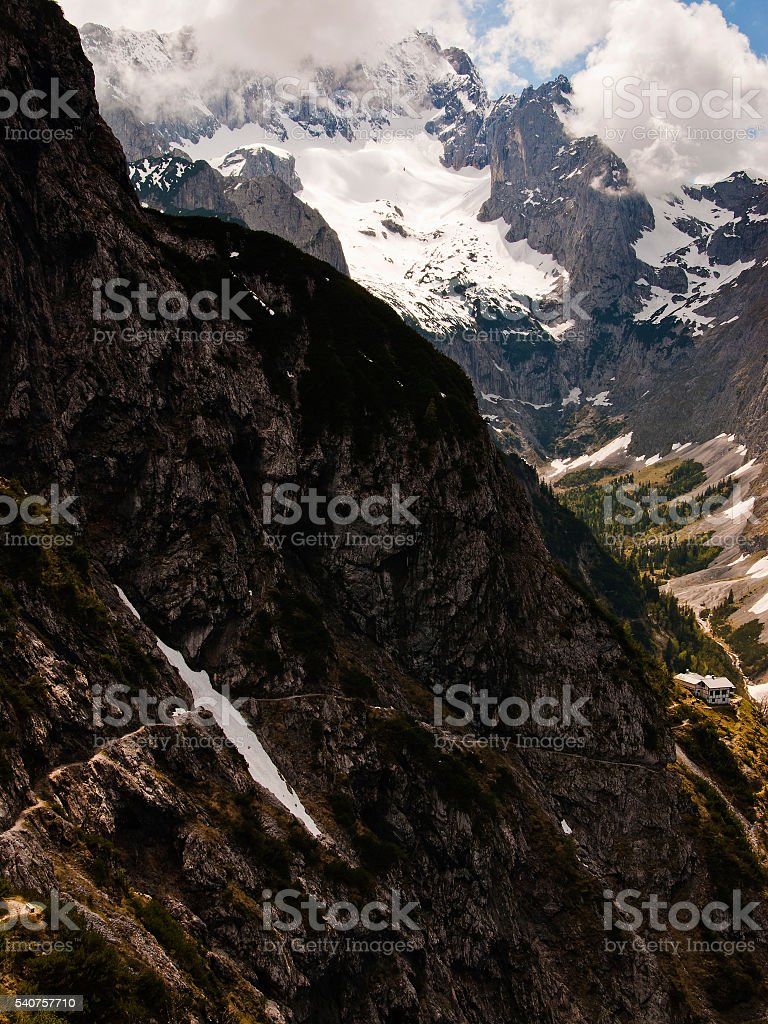 Snowy peak of Zugspitze in Wetterstein mountain range behind clouds stock photo