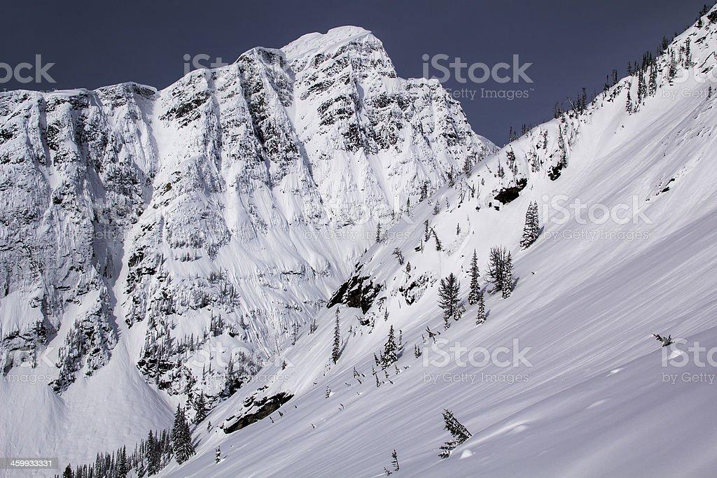Snowy peak with pristine snow stock photo