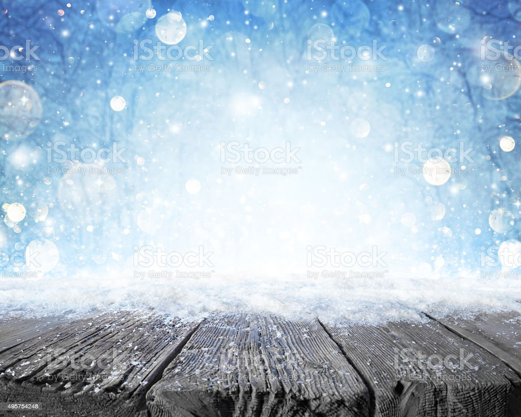 Snowy Plank With Wintry Forest Background stock photo