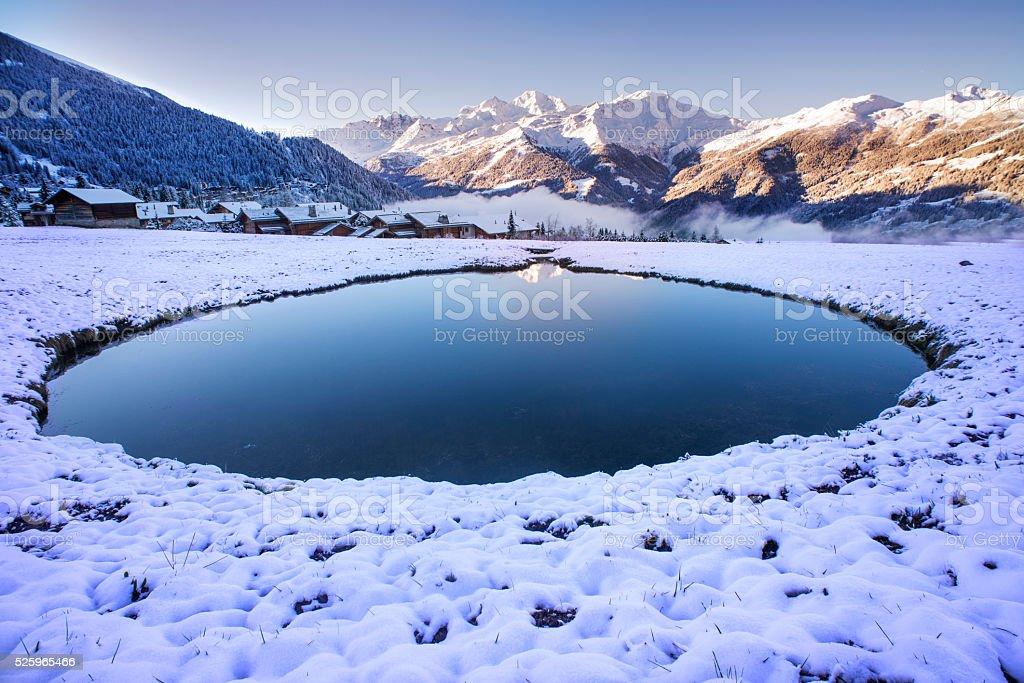Snowy pool sunrise stock photo