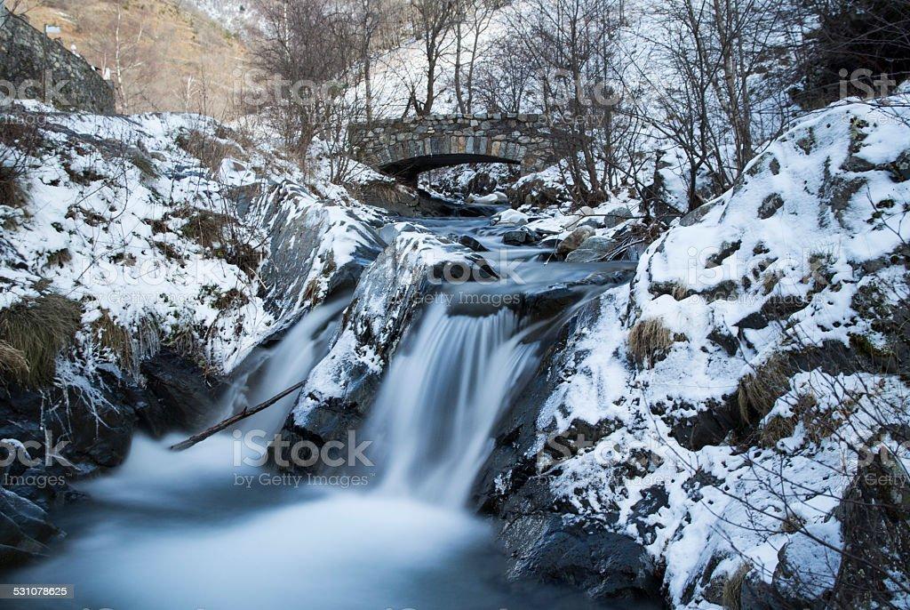 Snowy river in a winter landscape stock photo